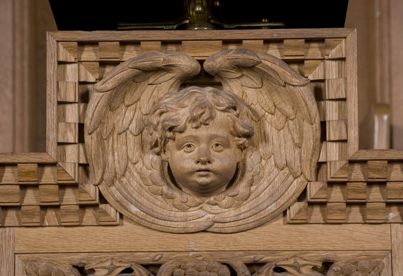 Interior. Detail of carved cherub on pulpit