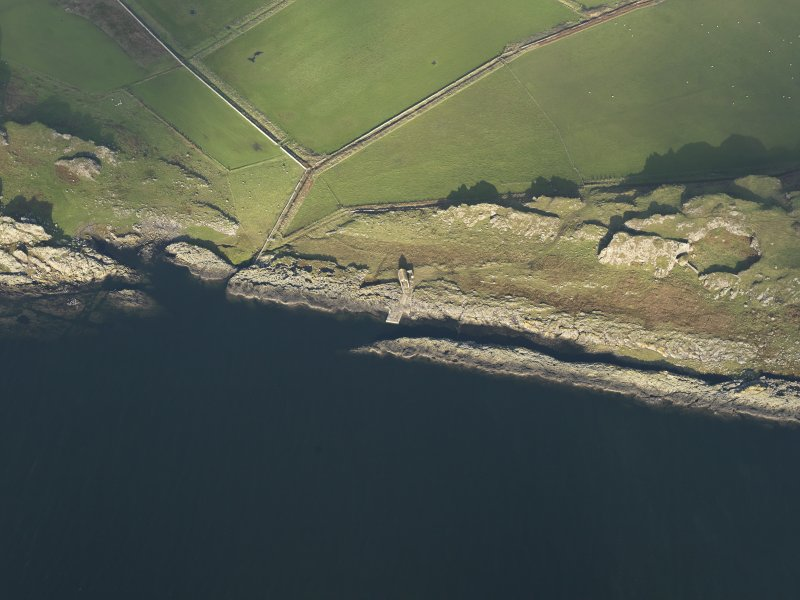 Oblique aerial view centred on the jetty, taken from the SW.