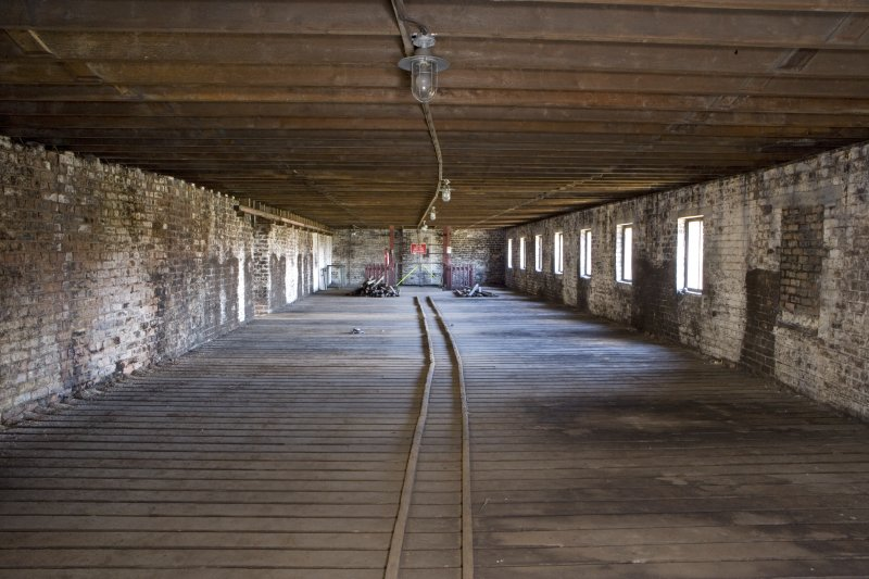 Interior view of bonded warehouse (west section) at rosebank Distillery. View looking along the barrel runners in the  N side of the warehouse towards the barrel hoist.