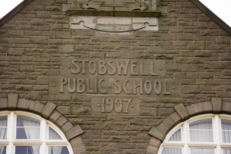 Detail of carved name and date in E facade of school from E.