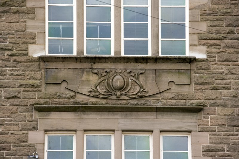 Detail of carved motif between first and second floor windows, taken from the E.