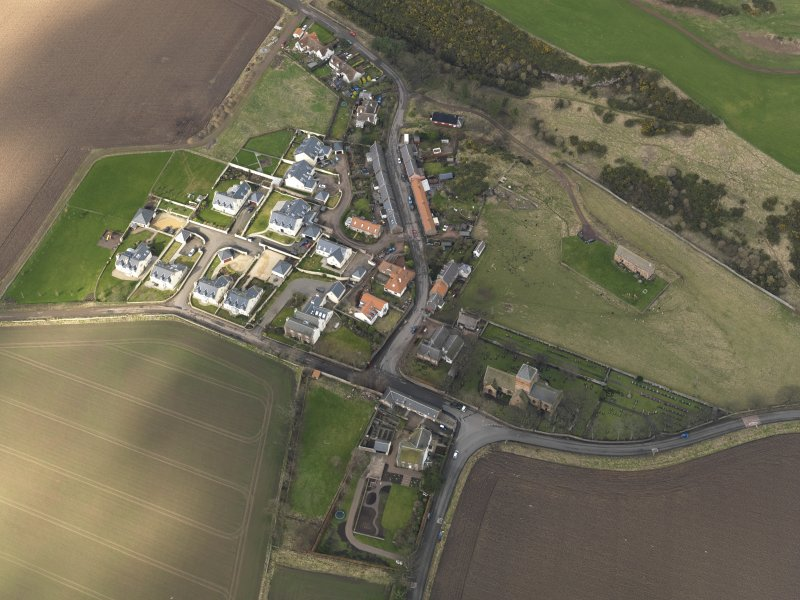 Oblique aerial view centred on the village with the parish church adjacent, taken from the SE.