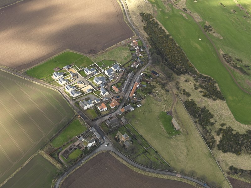 Oblique aerial view centred on the village with the parish church adjacent, taken from the ESE.
