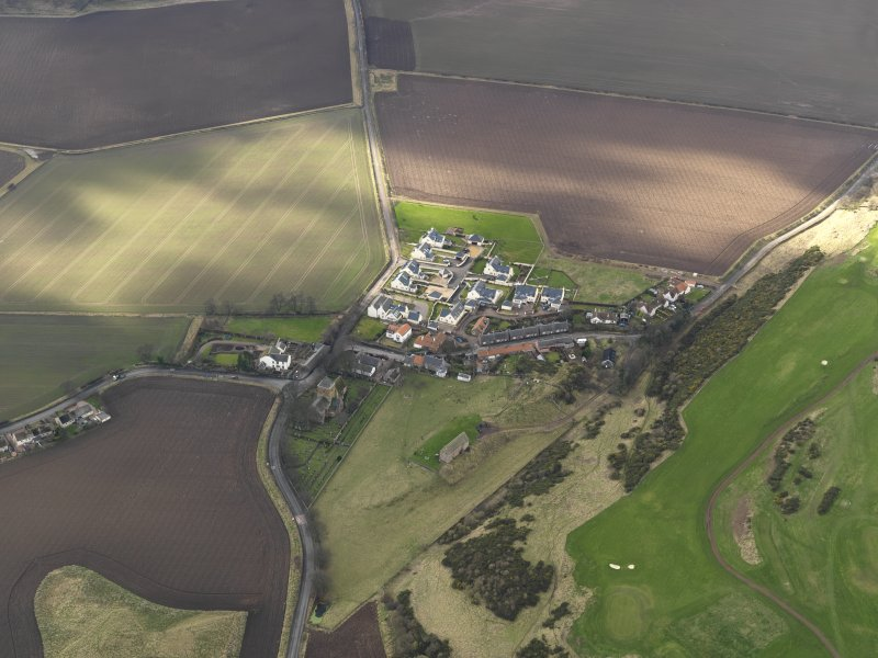 Oblique aerial view centred on the village with the parish church adjacent, taken from the ENE.
