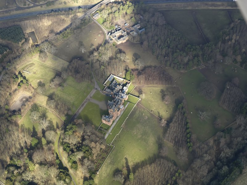 Oblique aerial view centred on the country house, taken from the SSW.