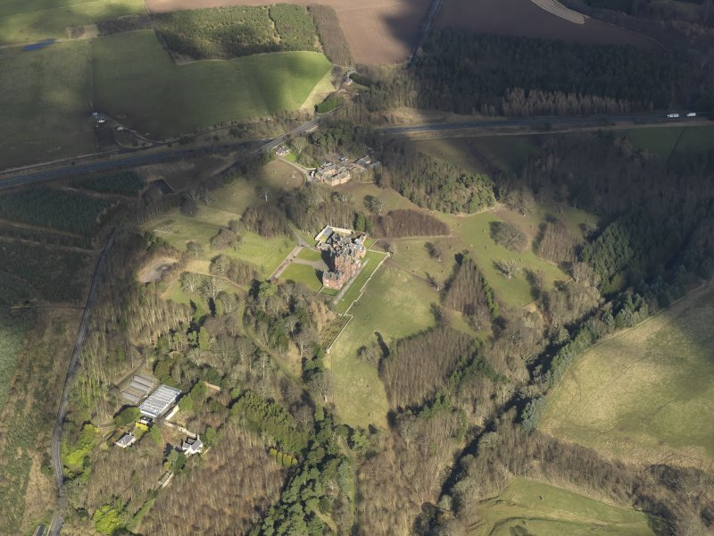 General oblique aerial view centred on the country house.