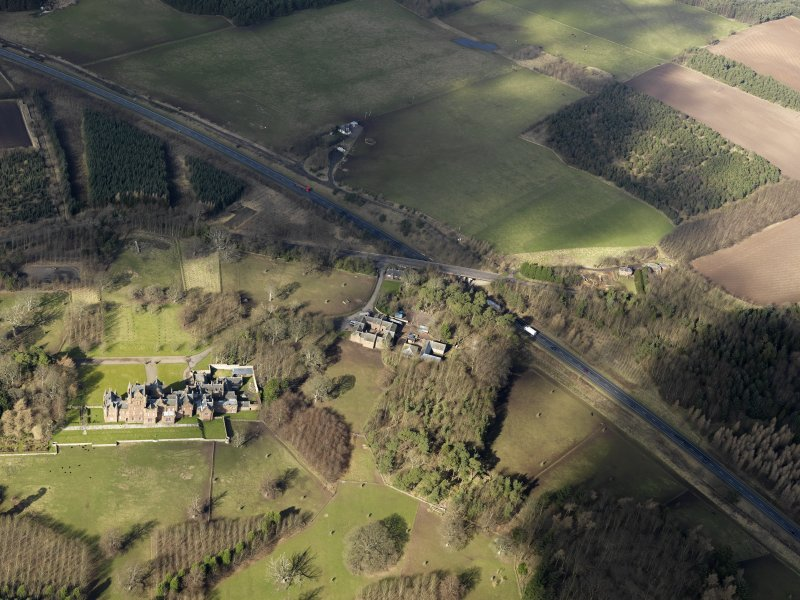 General oblique aerial view centred on the country house, taken from the SE.