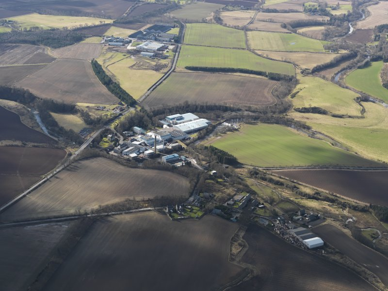 General oblique aerial view centred on the paper mill, taken from the NE.