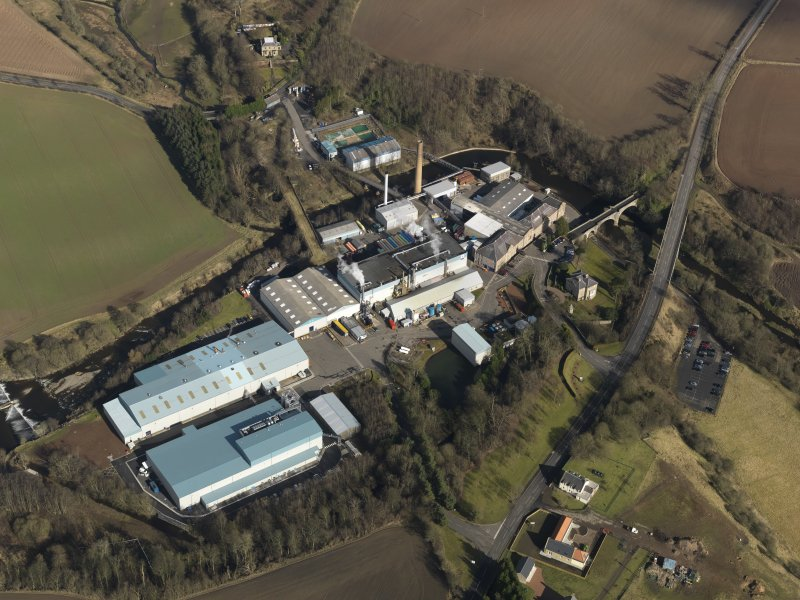 Oblique aerial view centred on the paper mill, taken from the SW.