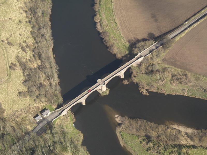 Oblique aerial view centred on the bridge with the toll house adjacent, taken from the SW.