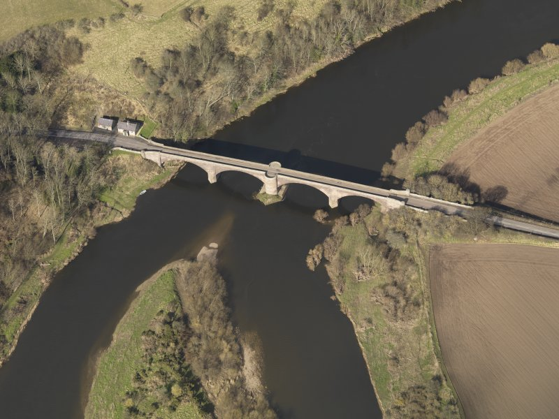 Oblique aerial view centred on the bridge with the toll house adjacent, taken from the S.