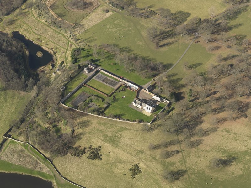 Oblique aerial view centred on the New Ladykirk House, taken from the SE.