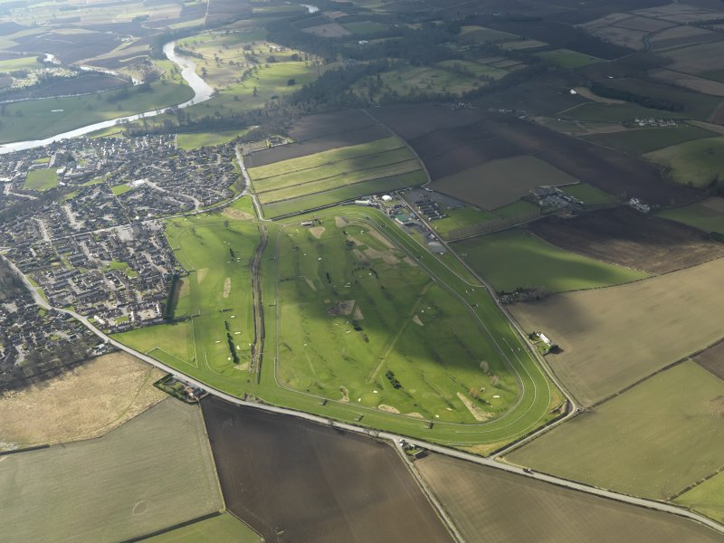 Oblique aerial view centred on the race course, taken from the ENE.