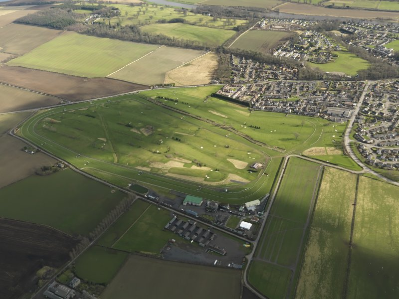 Oblique aerial view centred on the race course, taken from the NW.