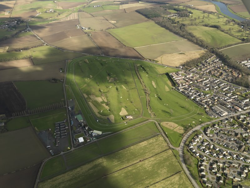 Oblique aerial view centred on the race course, taken from the SW.