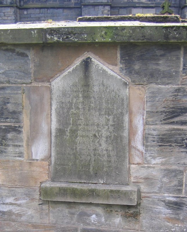 View of wall tablet in memory of Harry Rainy.
