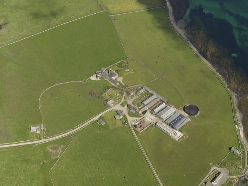 Oblique aerial view centred on the Hall of Tankerness with the farmstead and burial ground adjacent, taken from the WSW.