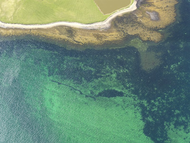 Oblique aerial view centred on a possible fish trap in the Bay of Firth off the west of Damsay, taken from the SE.