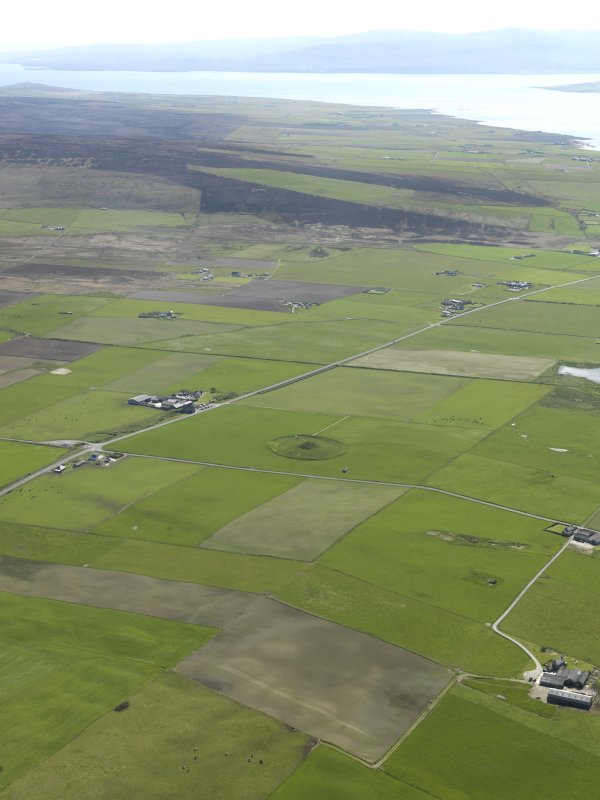 General oblique aerial view looking across Maes Howe with Hoy beyond, taken from the NE.