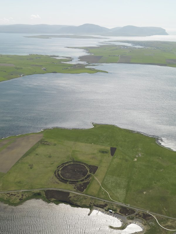 General oblique aerial view centred on the Ring of Brodgar with the Loch of Stenness and Hoy beyond, taken from the N.