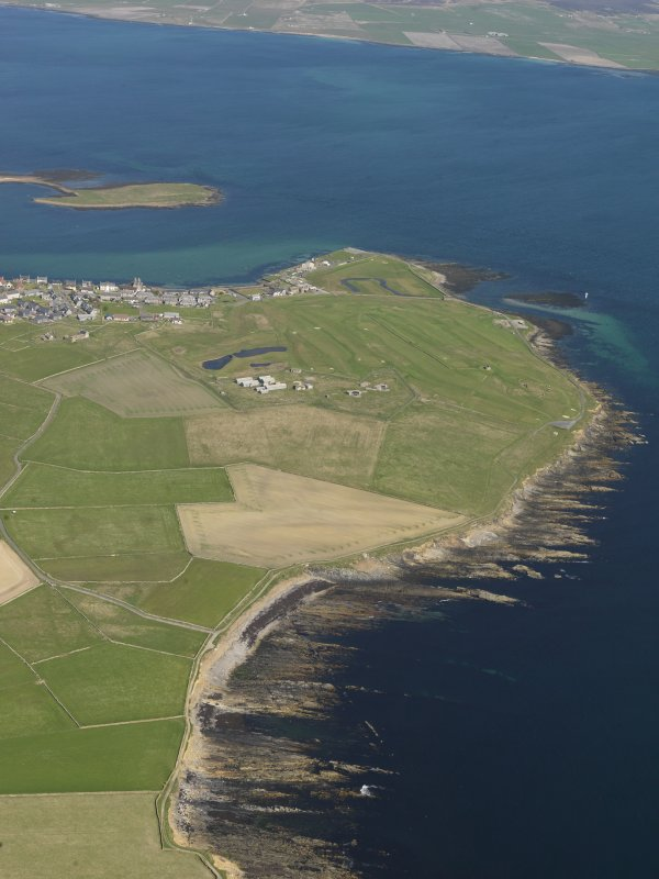 General oblique aerial view centred on Ness Battery with Stromness beyond, taken from the W.