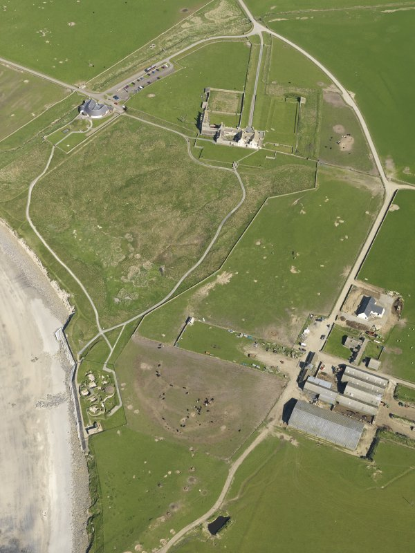 General olique aerial view centred on Skara Brae with Skaill House and farm adjacent, taken from the W.
