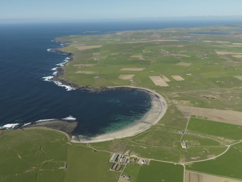 General oblique aerial view of the Bay of Skaill with Skara Brae, Skaill House and farm in the foreground, taken from the S.