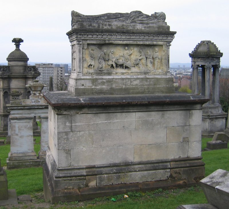 View of effigy on top of chest tomb.