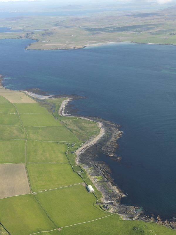 General oblique aerial view centred on Midhowe broch looking across Eynhallow Sound towards Aikerness and the Broch of Gurness, taken from the NW.