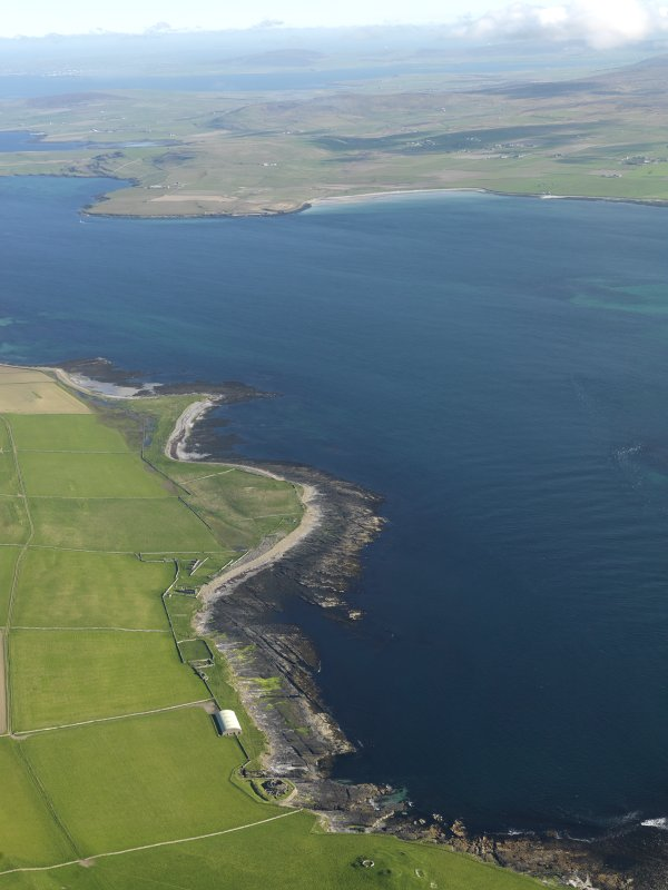 General oblique aerial view centred on Midhowe broch looking across Eynhallow Sound towards Aikerness and the Broch of Gurness, taken from the WNW.