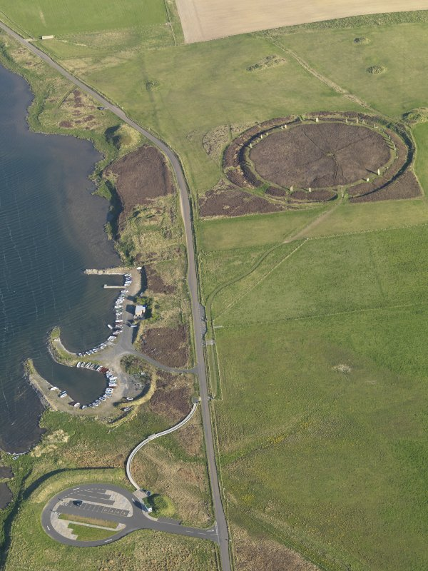 General oblique aerial view of the parking area and the Ring of Brodgar, taken from the NNW.