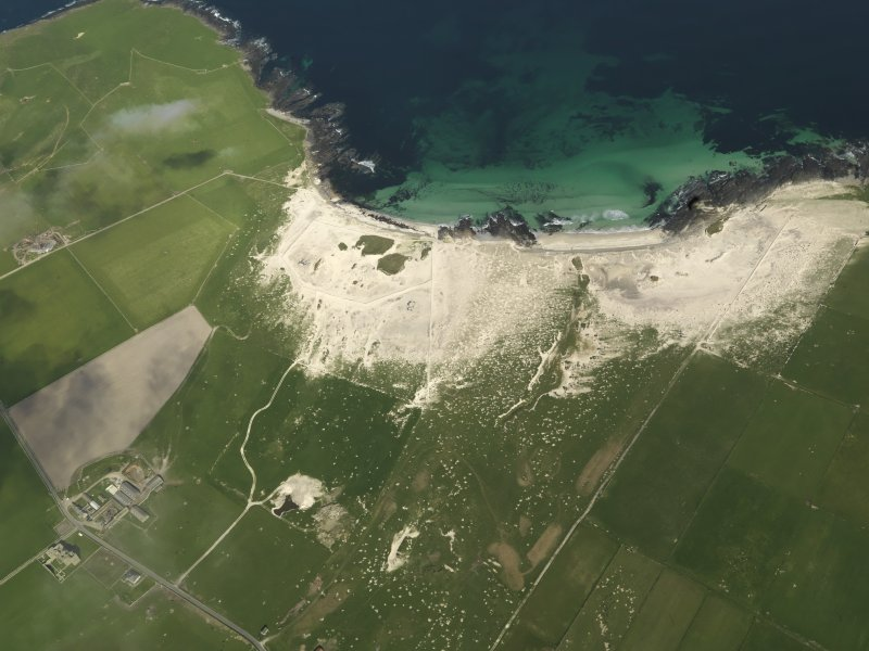 Oblique aerial view centred on Links of Noltland settlement, taken from the SE.
