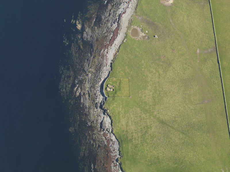 Oblique aerial view centred on the Knap of Howar neolithic settlement, taken from the SSW.