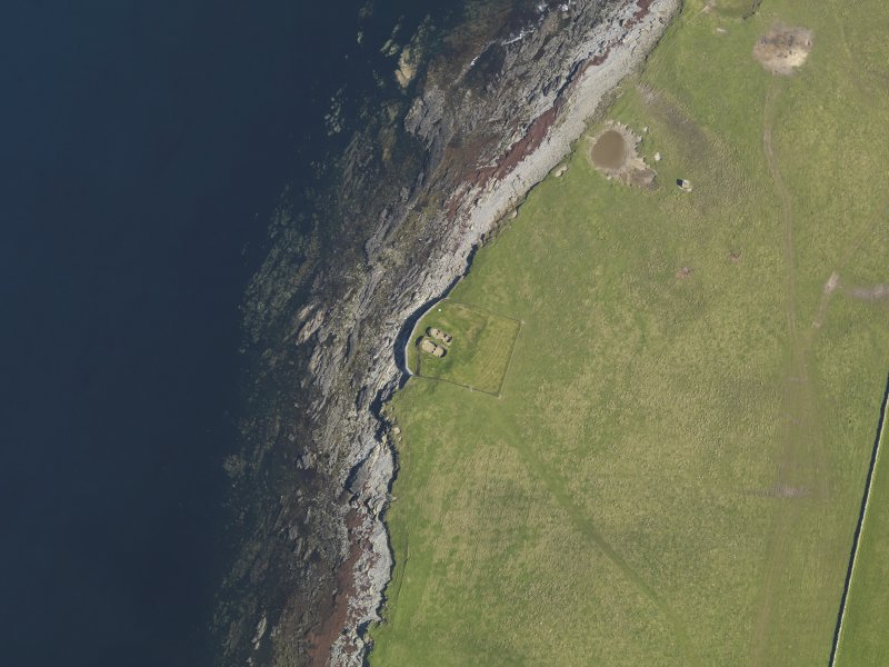 Oblique aerial view centred on the Knap of Howar neolithic settlement, taken from the SSE.