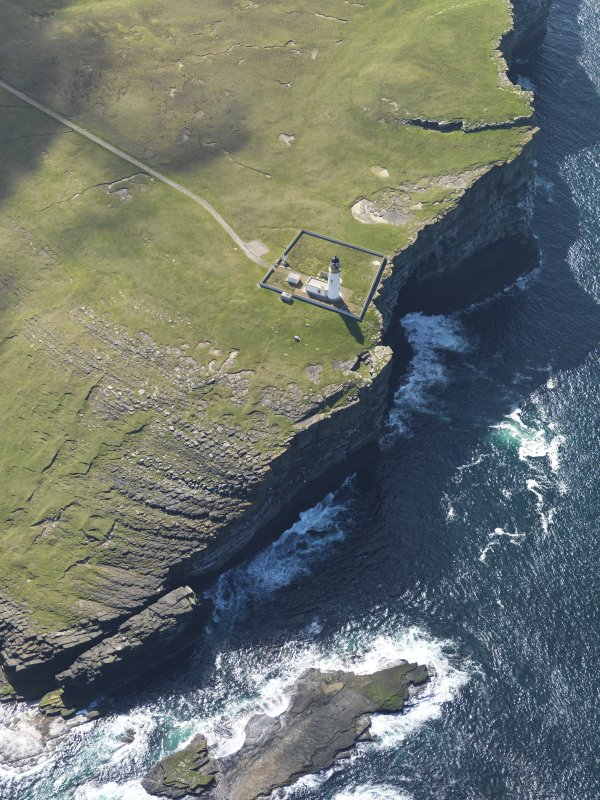 Oblique aerial view centred on Noup Head lighthouse, taken from the NW.