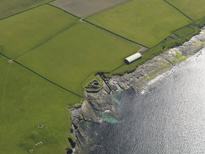 Oblique aerial view centred on Midhowe broch, taken from the W.