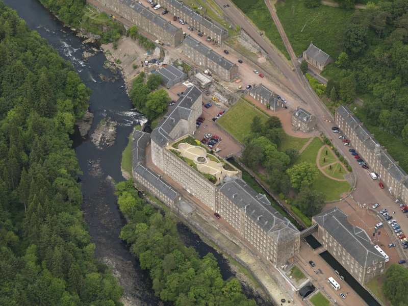 Oblique aerial view of New Lanark centred on the roof garden, taken from the SSE.