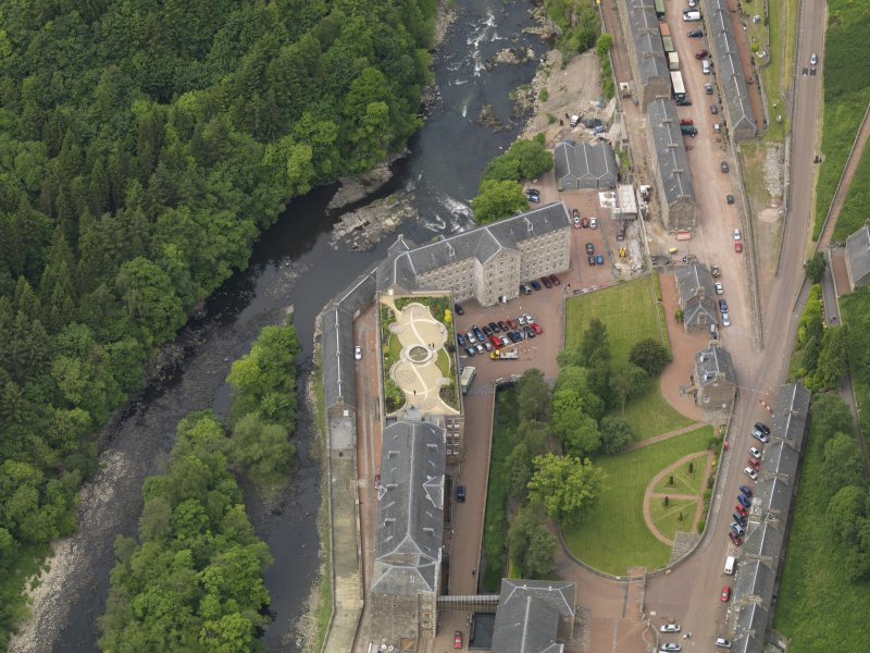 Oblique aerial view of New Lanark centred on the roof garden, taken from the ESE.
