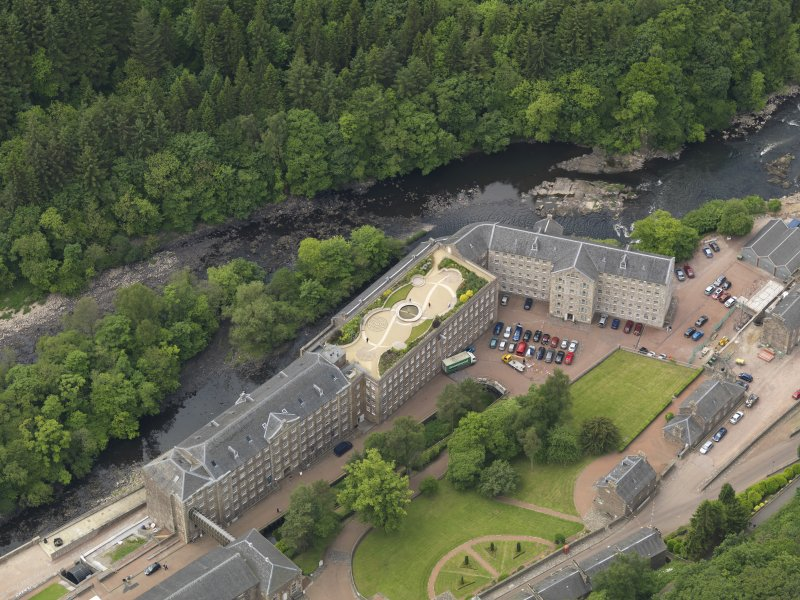 Oblique aerial view of New Lanark centred on the roof garden, taken from the ENE.