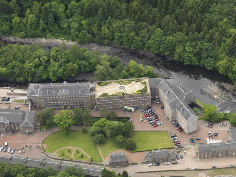 Oblique aerial view of New Lanark centred on the roof garden, taken from the NNE.