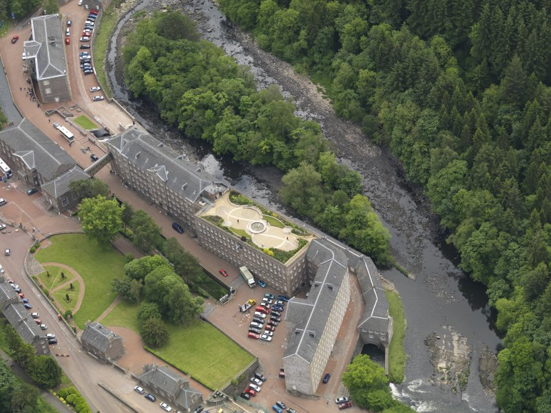 Oblique aerial view of New Lanark centred on the roof garden, taken from the NNW.
