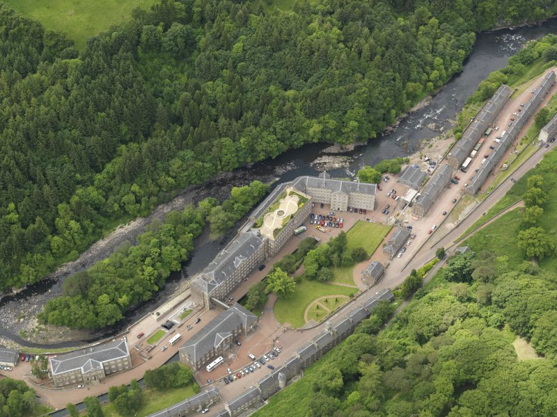 Oblique aerial view of New Lanark centred on the roof garden, taken from the E.