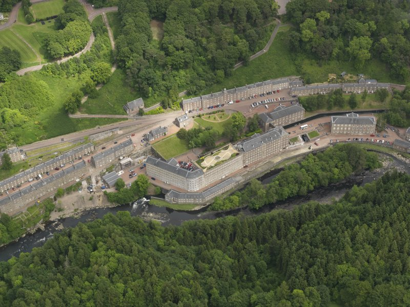 General oblique aerial view of New Lanark centred on the roof garden, taken from the WSW.