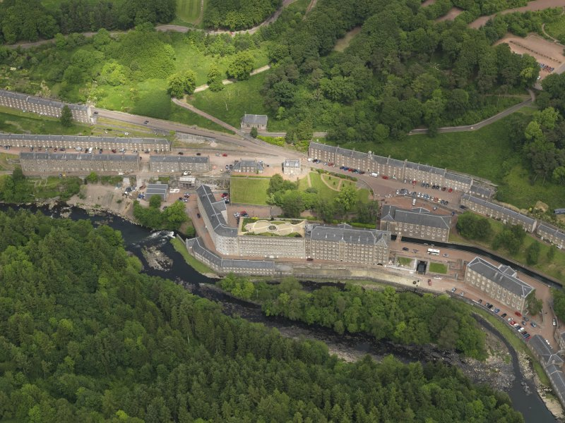 General oblique aerial view of New Lanark centred on the roof garden, taken from the SSW.