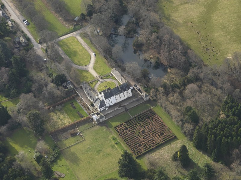 Oblique aerial view centred on the tower/country house with the garden adjacent, taken from the ENE.