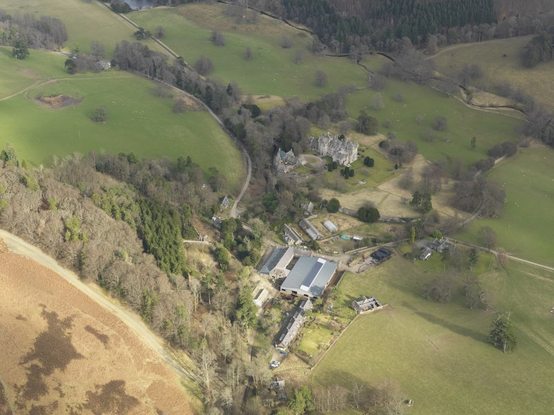 General oblique aerial view centred on the country house, taken from the W.