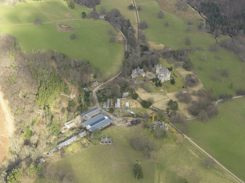 General oblique aerial view centred on the country house, taken from the SW.
