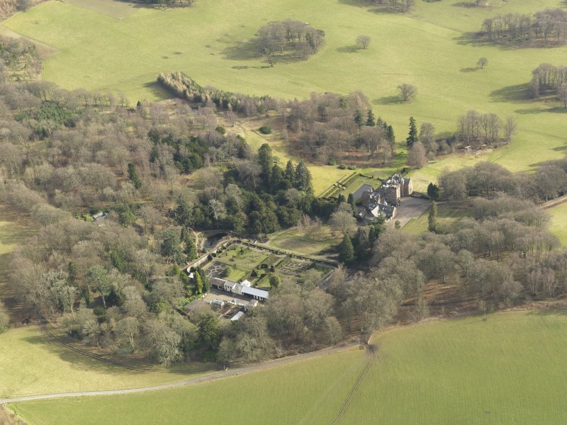 Oblique aerial view centred on the country house with the walled garden adjacent, taken from the NNW.