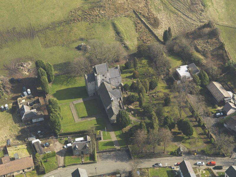 Oblique aerial view centred on the Preceptory and parish church, taken from the W.