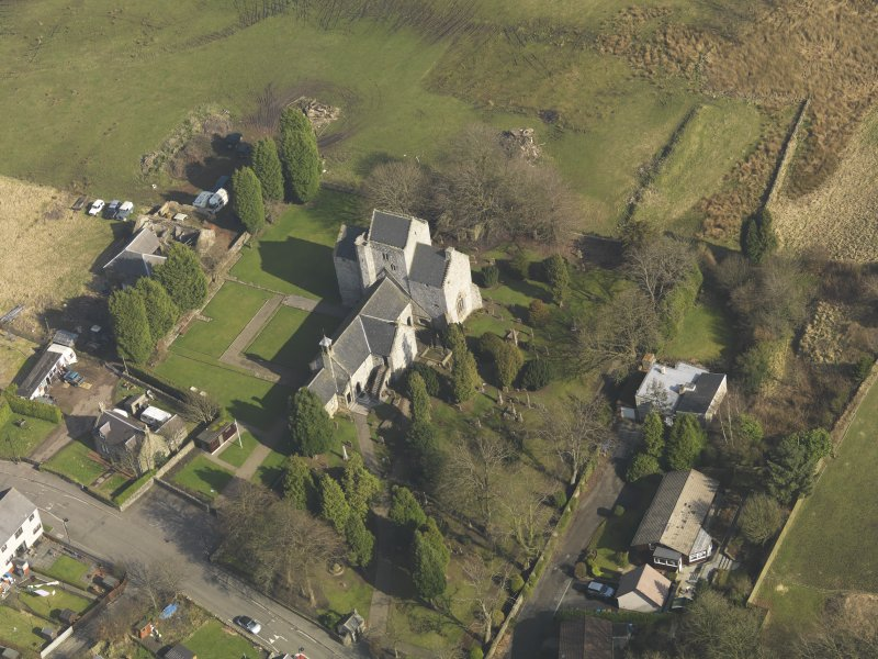 Oblique aerial view centred on the Preceptory and parish church, taken from the SW.